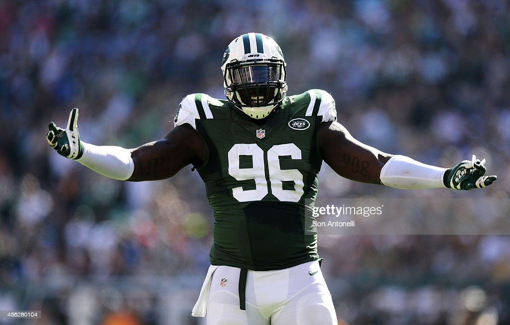 Muhammad Wilkerson #96 of the New York Jets reacts during their game against the Detroit Lions at MetLife Stadium on September 28, 2014 in East Rutherford, New Jersey.