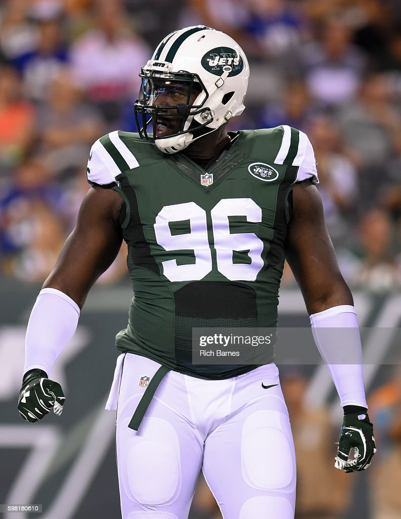 Muhammad Wilkerson #96 of the New York Jets reacts to a play against the New York Giants during the first quarter at MetLife Stadium on August 27, 2016 in East Rutherford, New Jersey. The Giants defeated the Jets 21-20.