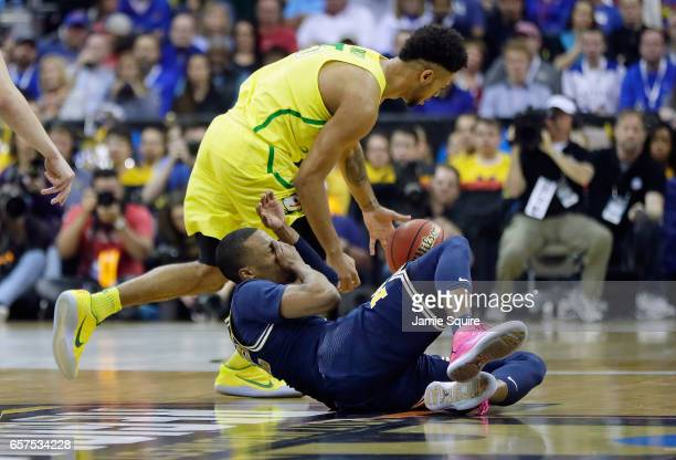 MuhammadAli AbdurRahkman of the Michigan Wolverines reacts after being hit by Tyler Dorsey of the Oregon Ducks during the 2017 NCAA Men's Basketball...