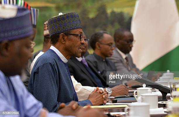 Muhammadu Buhari President of the Federal Republic of Nigeria attends a meeting with Chinese Premier Li Keqiang at Great Hall of the People on April...