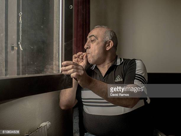 Muhammed Akkad from Syria smokes in his room where he lives with his two sons at the Hotel Arena on February 9 2016 in Halmstad Sweden Swedish...