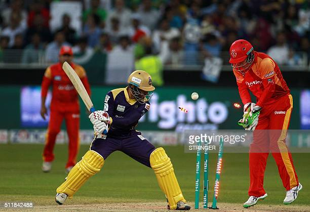 Muhammed Nawaz of Quetta Gladiators is blowled out by Samuel Badree of Islamabad United during the final of Pakistan Super League at the Dubai...