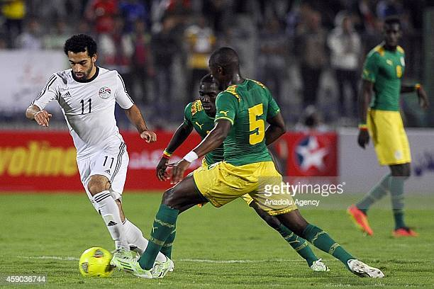 Muhammed Salah in action against Papakouli Diop of Senegal during the Africa Cup of Nations qualification group G match between Egypt and Senegal at...