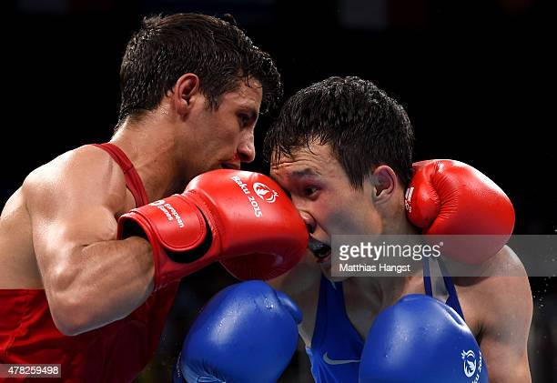 Muhammed Unlu of Turkey and Bator Sagaluev of Russia compete in the Men's Boxing Light Flyweight Semi Final during day twelve of the Baku 2015...