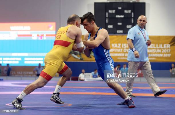 Muhammet Akdeniz of Turkey in action against Hugo Miguel Passos of Portugal during men's 59 kg grecoroman wrestling within the 23rd Summer...