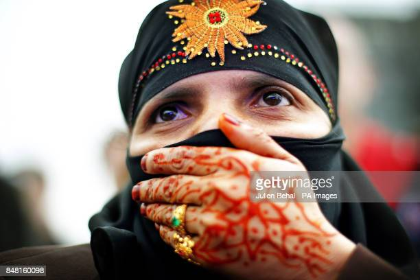 Muhamudda Khadun a Burmese citizen with traditional henna tattoos watches Burma's prodemocracy leader Aung San Suu Kyi after receiving the Freedom of...