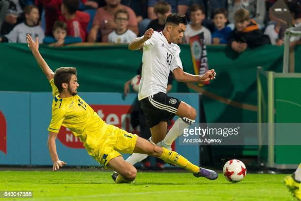 Muharrem Jashari of Kosovo and Nadiem Amiri of Germany in action during the U21 UEFA 2018 EM Qualifying match between Germany and Kosovo at the...