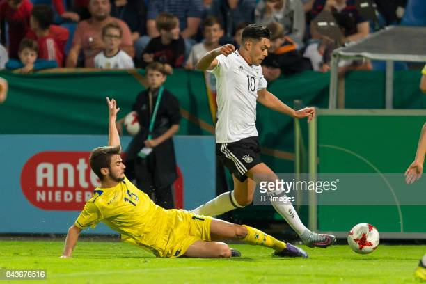 Muharrem Jashari of Kosovo und Nadiem Amiri of Germany battle for the ball during the U21 UEFA 2018 EM Qualifying match between Germany and Kosovo at...