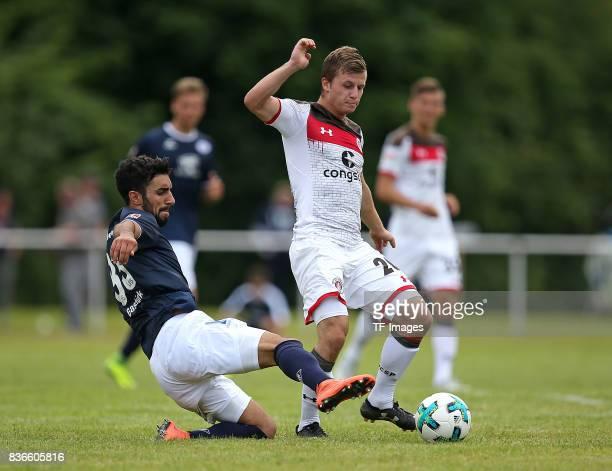Muhittin Bastuerk of Oldenburg and Richard Neudecker of St Pauli battle for the ball during the preseason friendly match between VfB Oldenburg and FC...