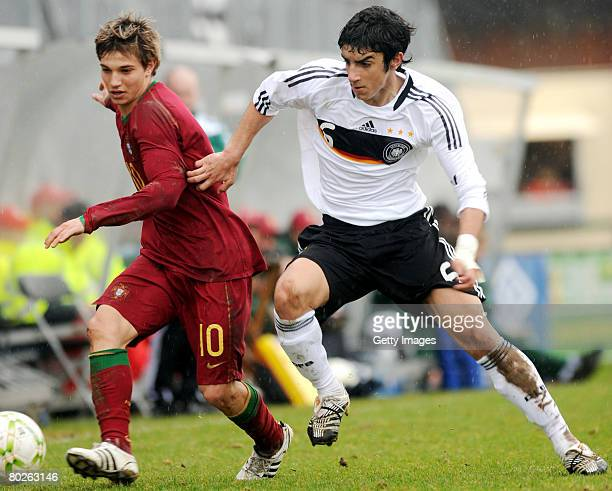 Muhittin Basturk of Germany challenges Cedric Soares of Portugal during the Men's U17 Euro qualifier match between Portugal and Germany at the...