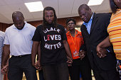 Muhiydin Moye D'Baha of the Black Lives Matter movement stands with activists following a North Charleston City Council meeting on April 9 2015 in...