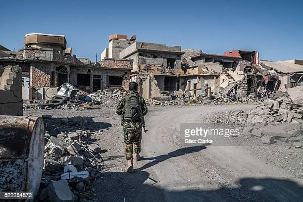 Muhsin Miro a 20 year Peshmerga army veteran patrolling the now ruined city of Sinjar in Kurdistan Muhsin is one of around 5000 Peshmergas who have...