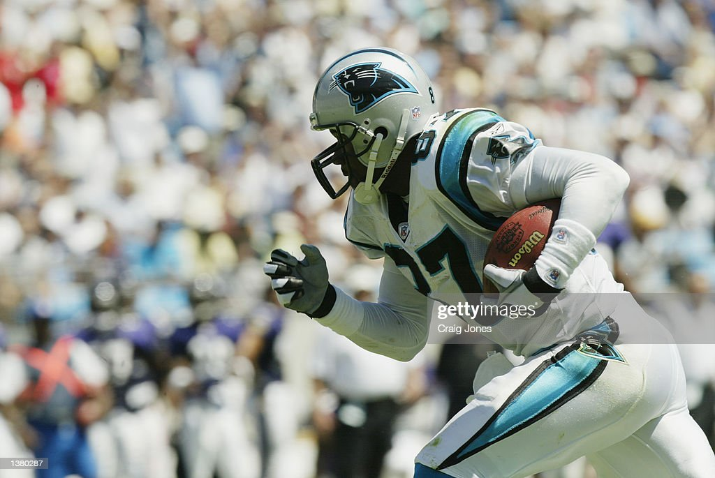 Muhsin Muhammad #87 of the Carolina Panthers carries the ball during the game against the Baltimore Ravens on September 8, 2002 at Ericsson Stadium in Charlotte, North Carolina. The Panthers defeated the Ravens 10-7.