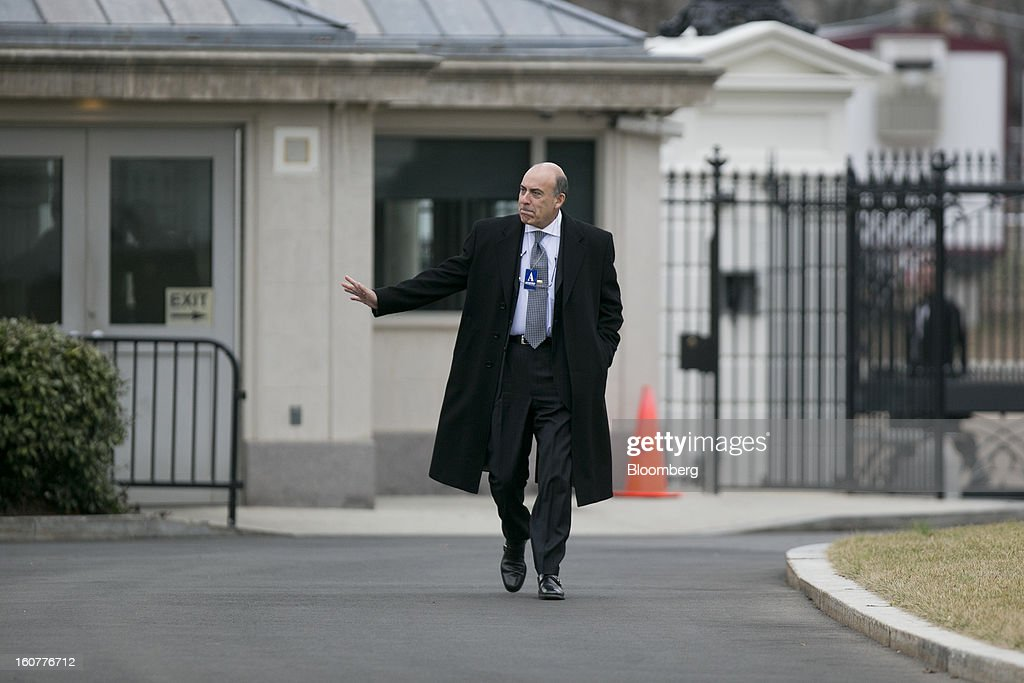 Muhtar Kent, chief executive officer of Coca-Cola Co., arrives to the White House to meet with U.S. President Barack Obama in Washington, D.C., U.S., on Tuesday, Feb. 5, 2013. Obama urged Congress to postpone automatic spending cuts scheduled to begin March 1 to avoid 'real and lasting impacts' on U.S. economic growth. Photographer: Andrew Harrer/Bloomberg via Getty Images