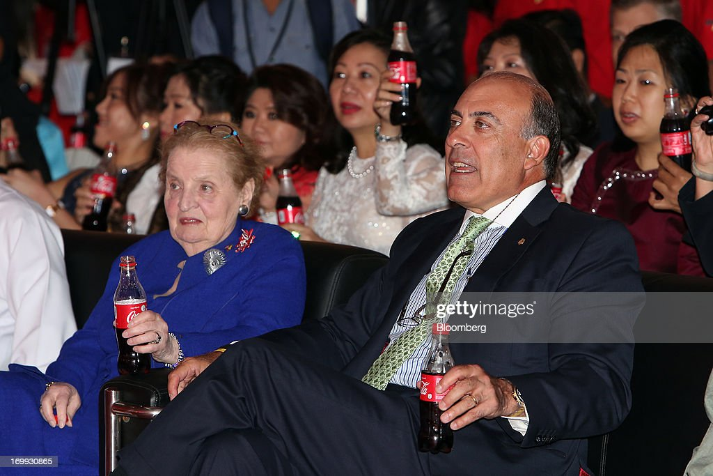 Muhtar Kent, chief executive officer of Coca-Cola Co., front right, and Madeleine Albright, former U.S. secretary of state, front left, hold bottles of Coca-Cola soda as they attend the opening ceremony for the company's bottling plant in Hmawbi, Myanmar, on Tuesday, June 4, 2013. Kent marked the return of the world's largest soda maker to Myanmar after 60 years by opening a bottling plant and pledging more investment in the newly opened economy. Photographer: Dario Pignatelli/Bloomberg via Getty Images