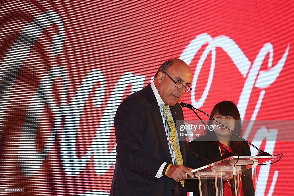 Muhtar Kent, chief executive officer of Coca-Cola Co., left, speaks during the opening ceremony for the company's bottling plant in Hmawbi, Myanmar, on Tuesday, June 4, 2013. Kent marked the return of the world's largest soda maker to Myanmar after 60 years by opening a bottling plant and pledging more investment in the newly opened economy. Photographer: Dario Pignatelli/Bloomberg via Getty Images