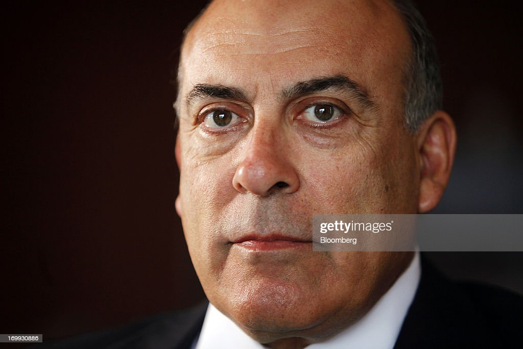 Muhtar Kent, chief executive officer of Coca-Cola Co., poses for a photograph during a Bloomberg Television interview in Yangon, Myanmar, on Tuesday, June 4, 2013. Kent marked the return of the world's largest soda maker to Myanmar after 60 years by opening a bottling plant and pledging more investment in the newly opened economy. Photographer: Dario Pignatelli/Bloomberg via Getty Images