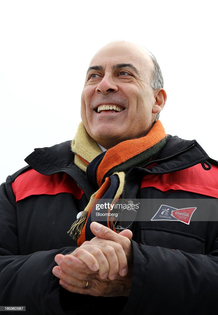 <a gi-track='captionPersonalityLinkClicked' href=/galleries/search?phrase=Muhtar+Kent&family=editorial&specificpeople=4365584 ng-click='$event.stopPropagation()'>Muhtar Kent</a>, chief executive officer of Coca-Cola Co., smiles during a visit to the 2013 Pyeongchang Special Olympics Winter Games in Pyeongchang, South Korea, on Wednesday, Jan. 30, 2013. The 2013 Pyeongchang Special Olympics Winter Games takes place from Jan. 29 to Feb 5. Photographer: SeongJoon Cho/Bloomberg via Getty Images