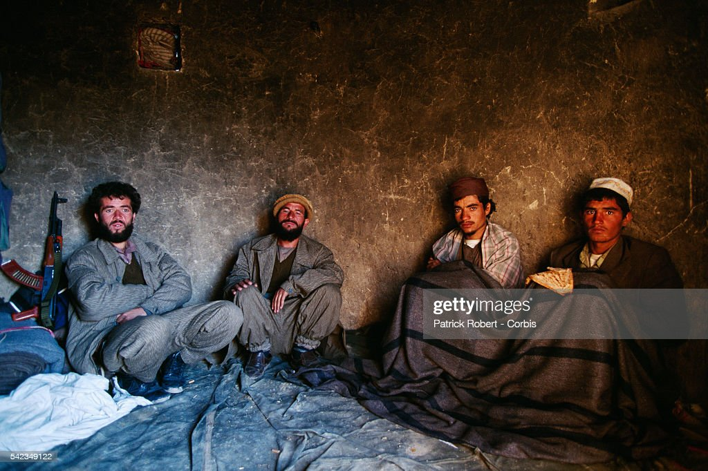 Mujahideen and two Taliban prisoners near the battle front to the north of Kabul The city was seized by the Taliban on October 27 1996 | Location...