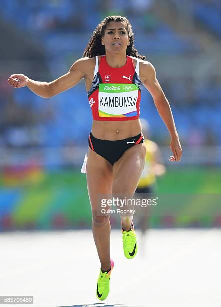 Mujinga Kambundji of Switzerland competes in round one of the Women's 200m on Day 10 of the Rio 2016 Olympic Games at the Olympic Stadium on August...