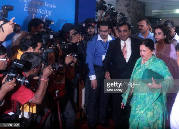 Mukesh D Ambani chairman of India's Reliance Industries Ltd arrives with his mother Kokilaben and wife Nita Ambani to the company's annual general...