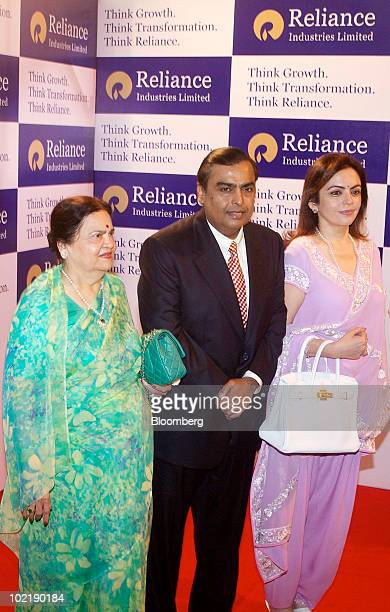 Mukesh D Ambani chairman of India's Reliance Industries Ltd center poses for a photograph with his mother Kokilaben left and his wife Nita at the...