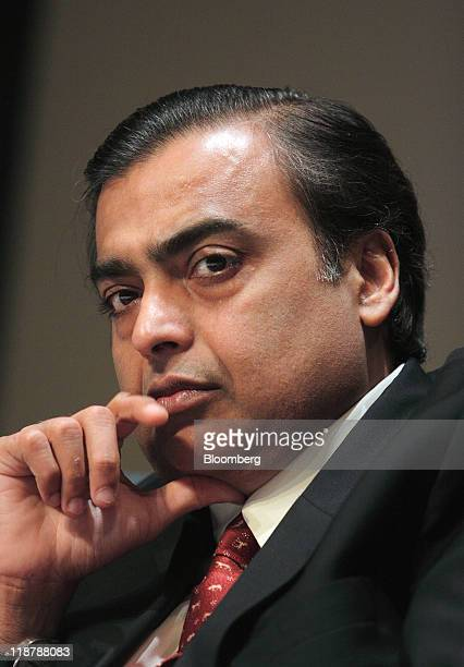 Mukesh D Ambani chairman of Reliance Industries Ltd attends the Ajay Mushran Memorial Lecture in New Delhi India on Sunday July 10 2011 Ambani said...