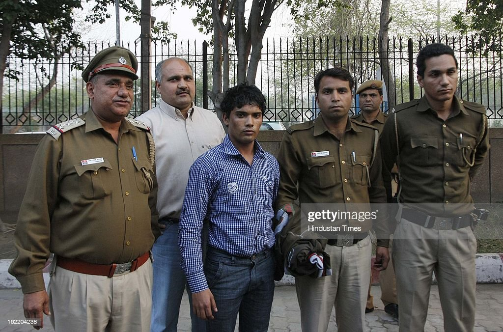 Mukesh, the accused for shooting at Naveen inside Rohini Court earlier during the day which result in his death on February 20, 2013 in New Delhi, India. Naveen an under trial in a murder case was shot twice in chest. The shooting is said to be result of Gang rivalry between Naveen and Ashwani both resident of Narela.
