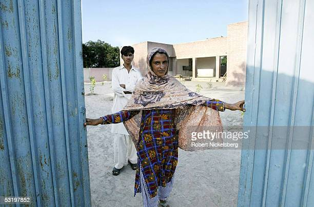 Mukhtiar Mai who was gang raped by 6 men from a more powerful clan living next door on June 22 poses with her brother August 25 2004 in Jatoimeerwala...