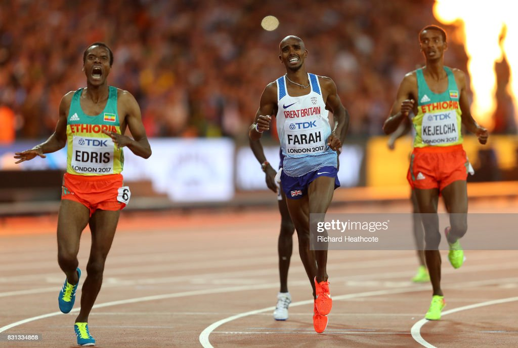 Muktar Edris of Ethiopia (L) and Mohamed Farah of Great Britain reacts as they cross the finishline in the Men's 5000 Metres final during day nine of the 16th IAAF World Athletics Championships London 2017 at The London Stadium on August 12, 2017 in London, United Kingdom.