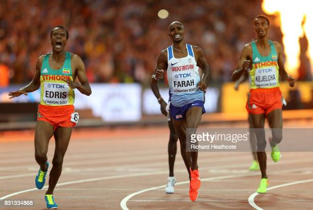 Muktar Edris of Ethiopia and Mohamed Farah of Great Britain reacts as they cross the finishline in the Men's 5000 Metres final during day nine of the...