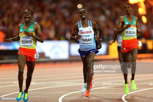 Muktar Edris of Ethiopia and Mohamed Farah of Great Britain reacts after crossing the finishline in the Men's 5000 Metres final during day nine of...