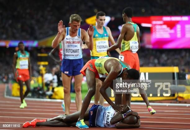 Muktar Edris of Ethiopia consoles Mohamed Farah of Great Britain after the Men's 5000 Metres final during day nine of the 16th IAAF World Athletics...