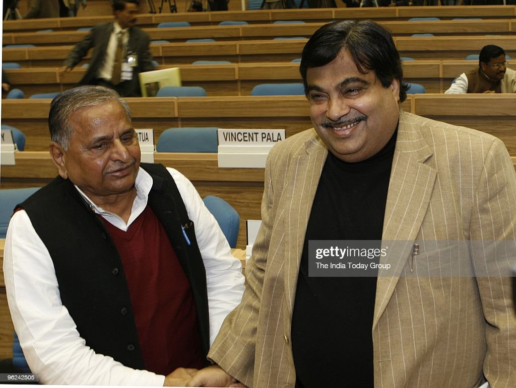 Mulayam Singh Yadav and Nitin Gadkari during the diamond jubilee celebrations of the Election Commission in New Delhi on Monday January 25 2010