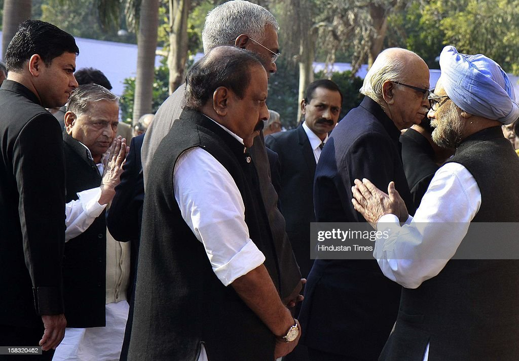Mulayam Singh Yadav chief of Samajwadi Party and greets to Prime Minister Manmohan Singh after pays homage to martyrs during a remembrance ceremony of the 2001 Parliament attack, at Parliament House on December 13, 2012 in New Delhi, India. Politicians gathered to observe the eleventh anniversary of a bloody militant attack on the complex, which left 14 dead on December 13, 2001.