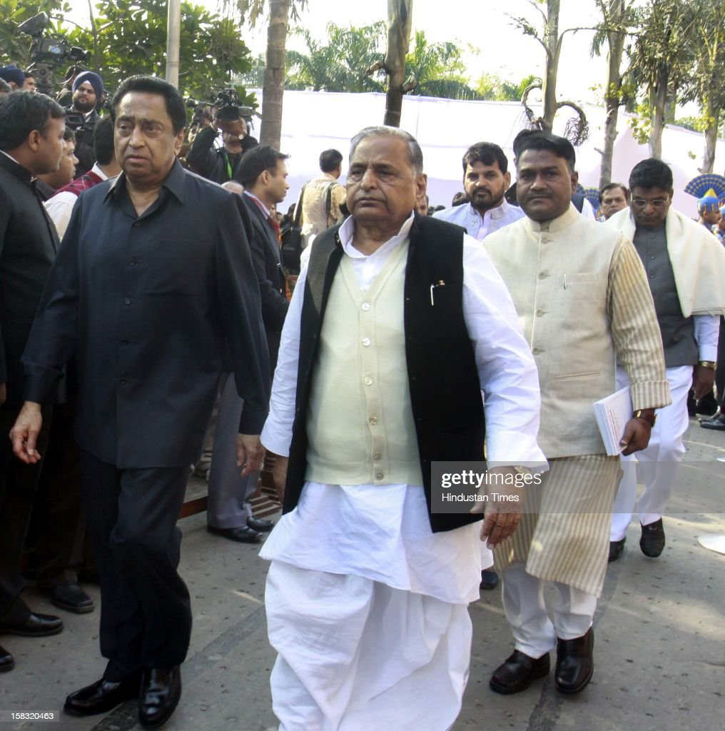 Mulayam Singh Yadav chief of Samajwadi Party and Parliamentary Affairs Minister Kamal after pays homage to martyrs during a remembrance ceremony of the 2001 Parliament attack, at Parliament House on December 13, 2012 in New Delhi, India. Politicians gathered to observe the eleventh anniversary of a bloody militant attack on the complex, which left 14 dead on December 13, 2001.