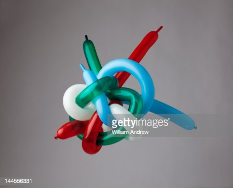 Muli-color balloons tied in giant knot