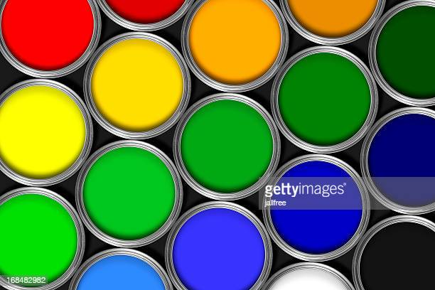 Mulit colored tins of paint in rows against black