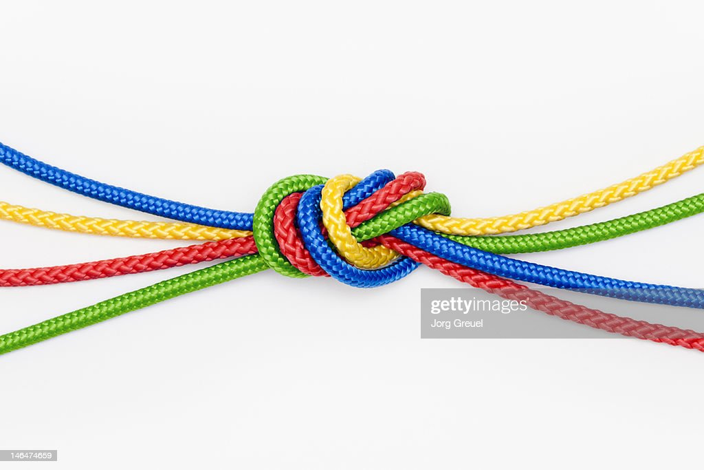 Mulitcolored ropes tied in a knot : Stock Photo