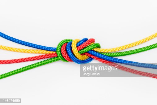 Mulitcolored ropes tied in a knot