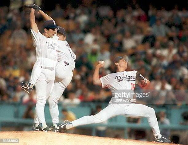 A mulitple exposure of Los Angeles Dodgers Hideo Nomo from Japan showing his pitching style 17 May during a game against the Pittsburgh Pirates in...