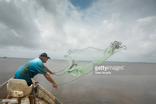 Mullet Fisherman Throwing a Cast Net