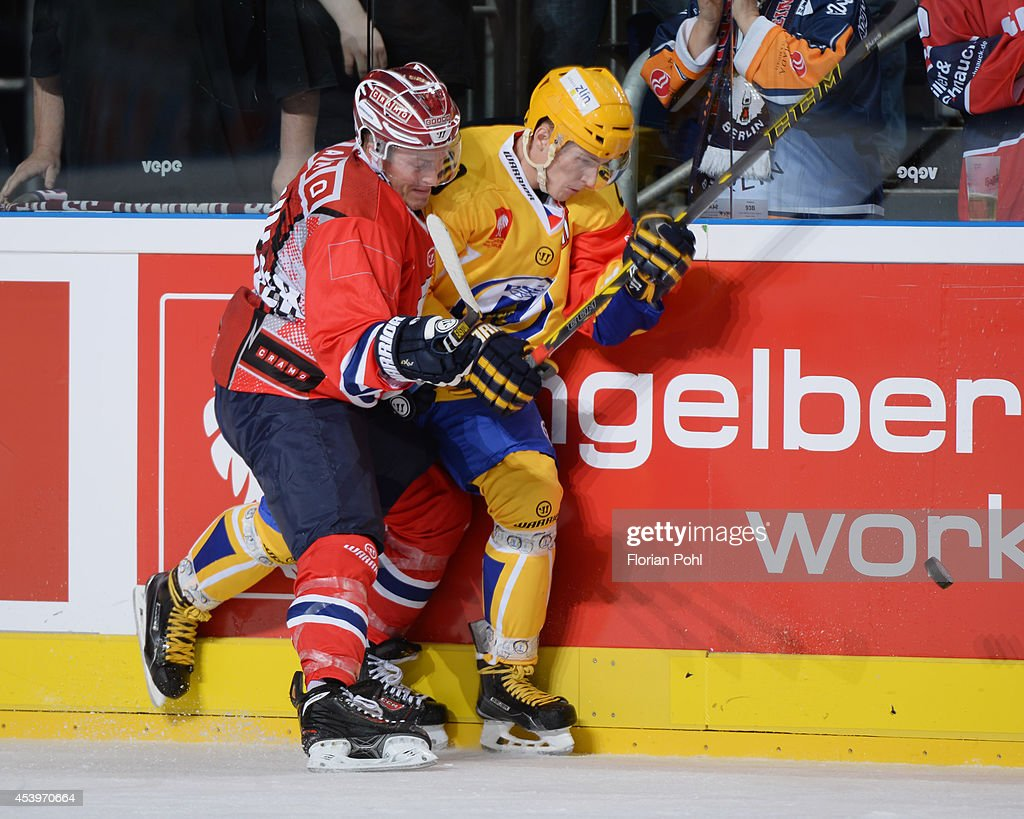 T.J. Mulock #15 of Eisbaeren Berlin und Lubomir Kovarik #10 of PSG Zlin body check during the Champions Hockey League group stage game between Eisbaeren Berlin and HC Zlin on August 22, 2014 in Berlin, Germany.