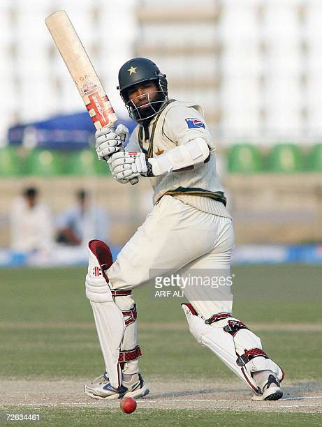 Pakistani cricketer Mohammad Yousuf watches the ball after playing a shot during the fifth and last day of the second cricket Test match between...