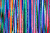 Multi color vivid tone stripe of Peruvian fabric for background, banner or texture