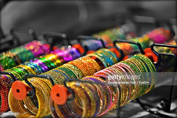 Multi Colored Bangles In Rack At Shop