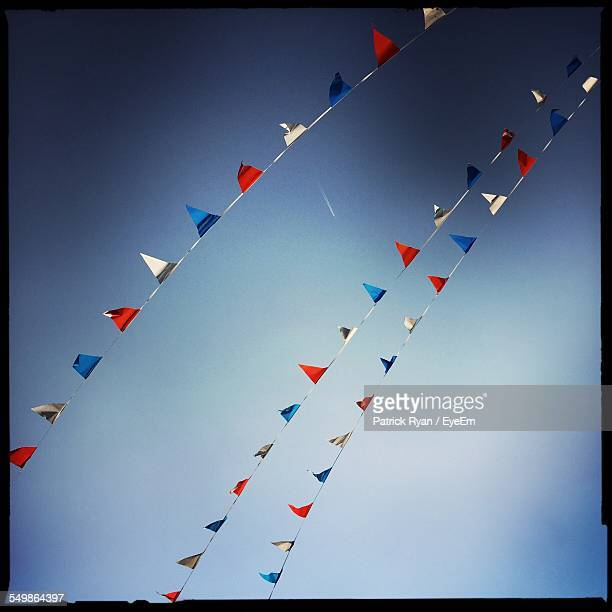 Multi Colored Bunting Against Clear Blue Sky