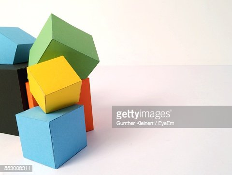 Multi Colored Cardboard Boxes On White Background
