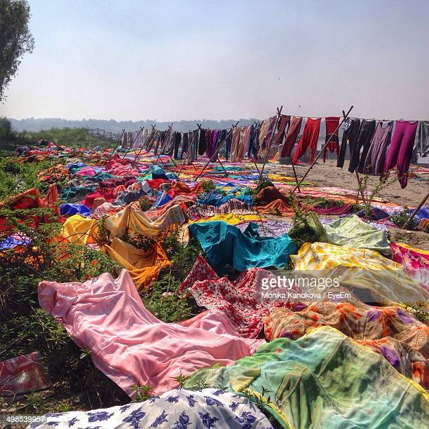 Multi colored clothes drying below the clear sky