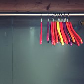 Multi Colored Coathangers Hanging From Rack